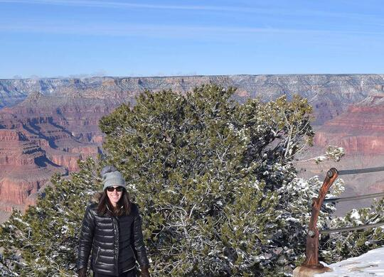 Lisa Nielsen standing by the Grand Canyon